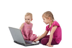 Kids playing computer game on laptop Stock Photos