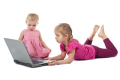 Kids playing computer game on laptop Royalty Free Stock Photos