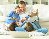 Kids playing computer games Stock Photos