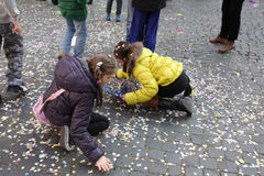Kids playing with confettis Stock Images