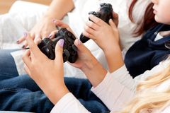 Kids playing console games using joystick. Closeup on kids hands playing console games using joystick Stock Photos
