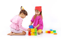 Kids playing with constructor. Portrait of two kids playing with constructor over white Stock Image