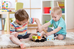 Kids playing with crane car toy together Royalty Free Stock Photography