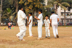 Kids playing Cricket stock photography