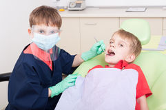Kids playing in dental office Royalty Free Stock Photo