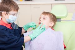 Kids playing in dentist office as doctor and patient Royalty Free Stock Photography