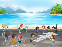 Kids playing different kinds of sports by the sea Royalty Free Stock Photography