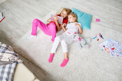 Kids Playing with Digital Tablet at Home royalty free stock image