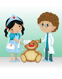 Kids Playing Doctor and Nurse. With the teddy bear Royalty Free Stock Image