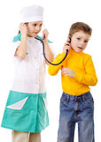 Kids playing in a doctor Stock Image