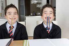 Kids playing while doing homework at home Stock Photo