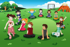Kids playing duck duck goose Stock Image
