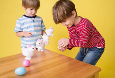 Kids playing with Easter Bunny Toys Royalty Free Stock Photo