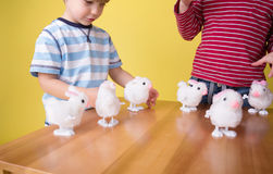 Kids playing with Easter Bunny Toys Royalty Free Stock Images