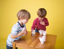 Kids playing with Easter Bunny Toys. Kids, children having fun and playing with wound up easter bunny toys stock photography