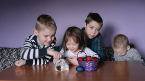 Kids are playing with Easter bunny stock video
