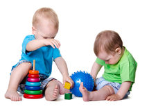Kids playing with educational toys stock photo