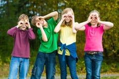 Kids playing with fake binoculars royalty free stock photos