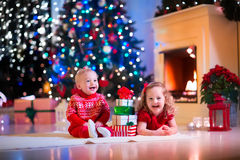 Kids playing at fireplace on Christmas eve Stock Images