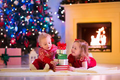 Kids playing at fireplace on Christmas eve Royalty Free Stock Photography