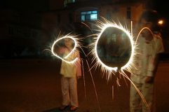 Kids playing fireworks Royalty Free Stock Images