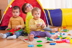 Kids playing on  floor. Funny kids playing on  floor with toys Stock Images