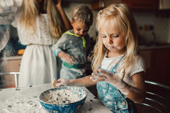 Kids is playing with flour Royalty Free Stock Photography