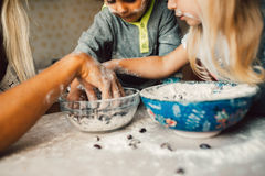 Kids is playing with flour Stock Image