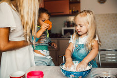 Kids is playing with flour Royalty Free Stock Photo