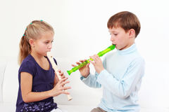 Kids playing flute Stock Photo
