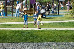 Kids playing football in Butovo park, Moscow, Russia stock image