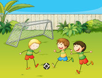 Kids playing football on football ground. Illustration of kids playing football on football ground Royalty Free Stock Images