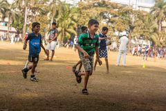 Kids playing football at Mumbai ground stock photos