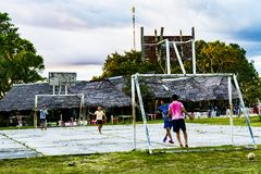 Kids playing football near the Amazon rainforest of Iquitos stock photo