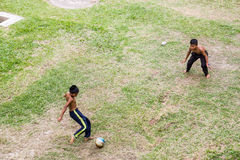Kids are playing football Stock Image