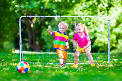 Kids playing football in school yard Royalty Free Stock Image