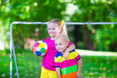 Kids playing football in school yard Royalty Free Stock Photography