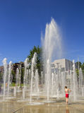 Kids playing in a fountain. Stock Photography