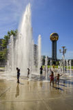 Kids playing in a fountain. Royalty Free Stock Photo