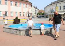 Kids playing on fountain Royalty Free Stock Photos