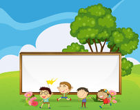 Kids playing in front of the big empty signboard Royalty Free Stock Photos