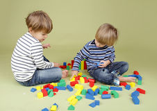 Kids Playing a Game, Sharing and Teamwork Stock Images