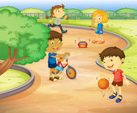 Kids playing in garden Stock Images