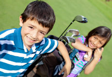 Kids playing golf Stock Photo