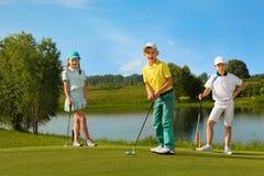 Free Kids Playing Golf Stock Photography - 67047352