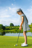 Kids playing golf Stock Image