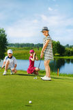 Kids playing golf Royalty Free Stock Photography