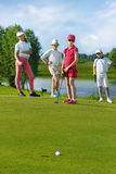 Kids playing golf Stock Images