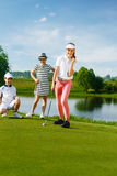 Kids playing golf. By putter on green Royalty Free Stock Photography