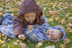 Kids playing on the grass. Bright autumn morning Stock Photography